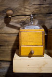 Closeup shot of old coffee mill on wooden table Stock Images