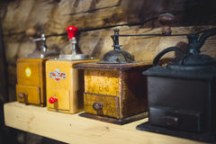 Closeup shot of old manual coffee mills on wooden table Stock Photography