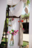 Closeup shot of the outdoors wedding decoration elements. Natural flowers at daylight Stock Photography