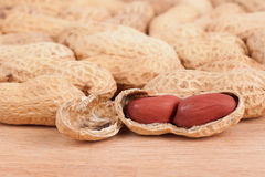 Closeup shot of peanuts on a wooden table. Top Royalty Free Stock Photos