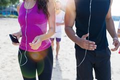 Closeup Shot Of People Running On Beach, Young Sport Runners Jogging Group Together Working Out At Seaside, Fit Male And. Female Joggers Multiracial Stock Photos