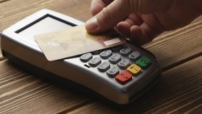 Contactless payment with credit card. Closeup shot of person using contactless payment with credit card stock footage