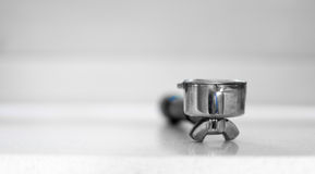 Closeup shot of a portafilter, a part in a coffee espresso machi Royalty Free Stock Image