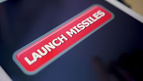 Closeup Shot Pressing Launch Missiles Button on Touchscreen Tablet PC. 8958 A closeup shallow DOF shot of a person click on the Launch Missiles button on a stock footage