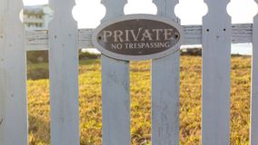 Closeup shot - Private No Tresspassing sign on picket fence stock images