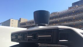 Closeup Shot of Radar Array Unit on Top of a Self Driving Uber Vehicle. 8935 PITTSBURGH, PA - Circa July, 2017 - A closeup detail shot of the spinning radar stock video footage