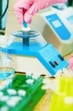 Test tube and centrifuge Royalty Free Stock Image