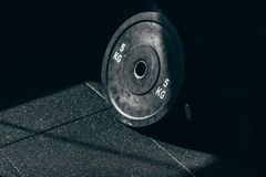 Closeup shot of a single dumbbell weight placed on the floor. At the gym stock photos