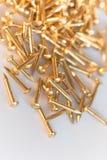 Closeup shot of small golden nails Stock Photos