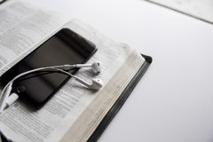Closeup shot of a smartphone on an opened bible