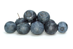 Closeup shot of some blueberries. Isolated on the white background royalty free stock images
