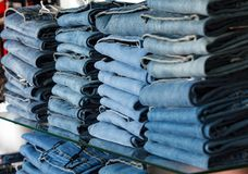 Closeup shot of stack of folded jeans Stock Photography