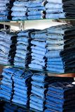 Closeup shot of stack of folded jeans Royalty Free Stock Images