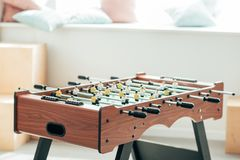 Closeup shot of table football with cushions on window sill royalty free stock images
