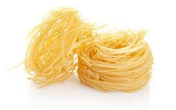 Closeup shot of tagliatelle isolated on white Stock Images