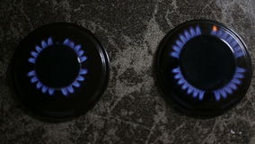 A closeup shot of two gas burners in a line disposed on the stove . Top view composition. A closeup shot of two gas burners in a line disposed on the stove stock video