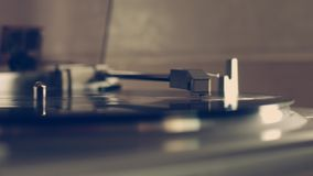 A closeup shot of a vinyl record spinning on a vintage record player in 4k. stock video