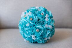 Closeup shot of a wedding accessory with blue flowers and precious stones