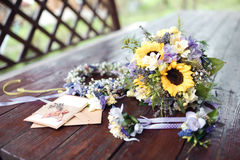 Closeup shot of the wedding bouquet, wreath and invitations. At daylight Stock Photo