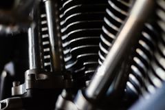 Closeup shot of a well ridden v-twin american made  motorcycle engine. The dirt, wear and various tool and road marks shows a machine well used and loved by royalty free stock image