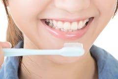 Closeup shot of woman brushing teeth Stock Images