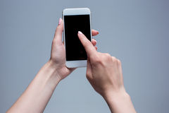 Closeup shot of a woman typing on mobile phone Royalty Free Stock Image