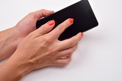 Closeup shot of a woman typing on mobile phone  on white Stock Photography