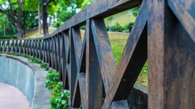 A wooden brown fence in the park royalty free stock photos