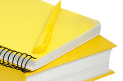 Closeup shot of  yellow book, copybook and pen Stock Images