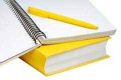 Closeup shot of  yellow book, copybook and pen Royalty Free Stock Photos