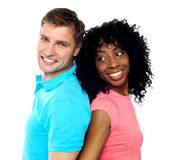 Closeup shot of young couple. Back to back. Closeup shot of young attractive couple posing back to back Royalty Free Stock Images