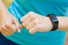 Closeup shot of young female runner arms with sports smartwatch. Royalty Free Stock Photography