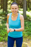 Closeup shot of young female runner ready to run with sports sma Stock Photo