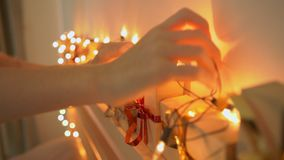 Closeup shot of a young woman preparing a Christmas edvent calendar.  stock footage