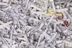 Shredded Paper Closeup with Some Color. Closeup of Shredded Paper from a paper shredder with a few colored pieces Royalty Free Stock Photo