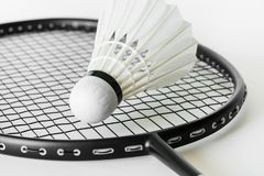 Closeup of shuttlecock and racket stock photo