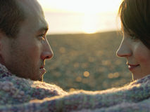 Closeup Side View Of Couple Looking At Each Other At Beach stock photography