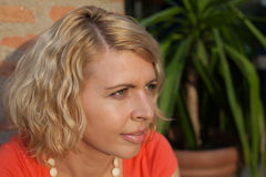 Closeup side view of a focused blonde woman Stock Images
