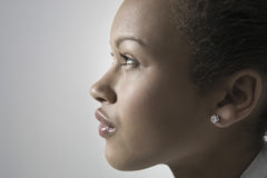 Closeup Side View Of Thoughtful Woman Stock Image