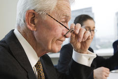 Closeup side view of two executives. Royalty Free Stock Photography