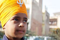 Closeup of a sikh child with saffron turban Royalty Free Stock Images