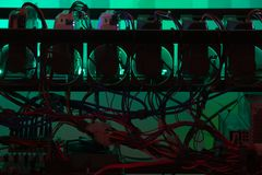 Closeup silhouette of DIY crypto mining rig. In operation stock photo