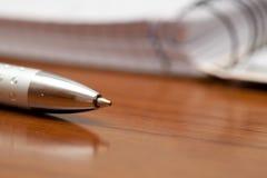 Closeup of a silver ballpoint pen Royalty Free Stock Photography