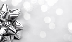 Closeup of silver bow on abstract background Stock Images