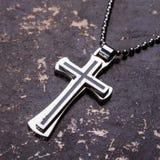 Closeup of silver Christian cross Stock Photo