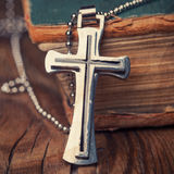 Closeup of silver Christian cross Royalty Free Stock Images
