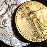 Silver eagle and golden american eagle one ounce coins royalty free stock photo