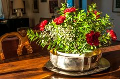 Closeup of silver flowerpot in living room. On a wooden table in a sunny afternoon, orange, arrangement, background, beautiful, bouquet, color, decoration stock photography