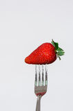 Closeup silver fork with delicious red strawberry Royalty Free Stock Photography