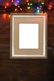 Closeup silver frame with christmas lights Stock Image